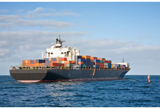 Heavily Laden Container Ship Leaving Port